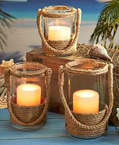 Bring the coast to your home with a Nautical Rope Candle Lantern. The neutral color of the rope blends flawlessly with any decor. Set your favorite candle insid accent decorative, Nautical Rope Candle Lanterns Jute Crafts, Diy Home Crafts, Wood Crafts, Candle Lanterns, Diy Candles, Glitter Candles, Candle Wax, Glass Candle, Sisal