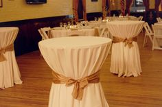 Gorgeous Bistro Tables with white linens and gold ribbons #beamroomcatering #brc #wilmington @nc  photo © BRC
