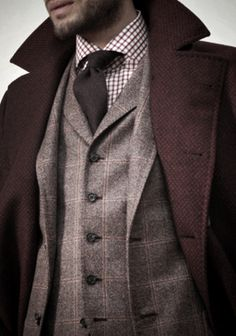 the burgundy woven coat over a  wool suit is very cool for winter.