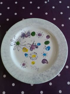 Tilly's birthday plate decorated with her guests fingerprints at Craft & Clay