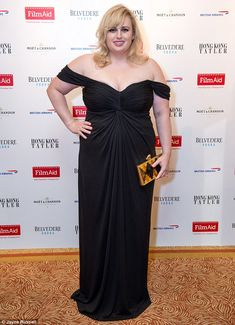 Rebel Wilson (pictured) dazzled in an off-the-shoulder black gown at a fundraiser for global charity FilmAid in Hong Kong