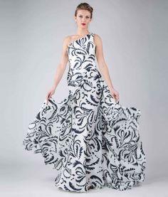 #italianStyle #madeinitaly Single-shoulder long dress, pattern on white textile, overlapped asymmetric panel skirt