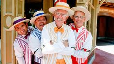 Smiling faces of a barber shop quartet outside the Harmony Barber Shop on Main Street, U.S.A.