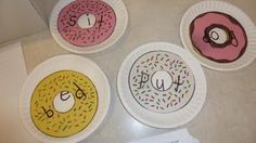 """Donut Words- if you pick up the """"donuts"""" and move them to a different plate, you get a different word because your vowel changes.  so the word PUT can become PET and PIT etc...They take a donut out of the donut box and lay it on a plate with a vowel to sound out a new word.  Then they can record it on the donuts word list."""
