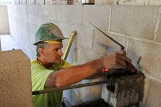 Justin Hunt, a mason with Creative Design Masonry, works on a partition wall at the Breathe Building in Southeast Portland. http://djcoregon.com/news/2014/08/06/photos-living-building-project-challenges-project-team/