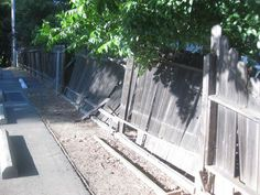 Easy, Illustrated Instructions on How to Fix a Wooden Fence