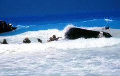 DF-ST-86-08060  A rubber raft carrying members of a U.S. Navy Sea-Air-Land (SEAL) team and Egyptian marines capsizes in the surf during an amphibious landing. They are participating in the multinational joint service Exercise BRIGHT STAR '85.