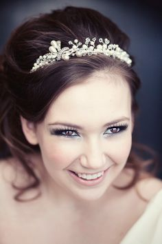Beautiful bridal makeup.  Love the blue around the bottom of the eye - I'd like a little less eyeliner though.