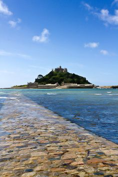 St. Michael's Mount is a tidal island off the coast of Cornwall, united with the town of Marazion by a man-made causeway and passable at low tides