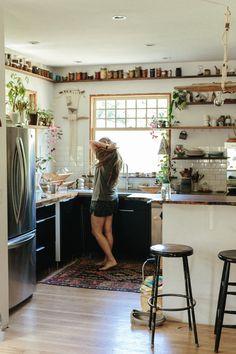 open storage with plants in kitchen