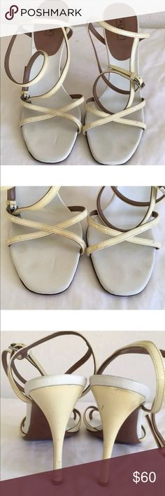 "ALAIA Yellow Patent Leather Strappy Sandals Sz 6.5 From French designer Azzedine Alaia come this sexy sandals. Features include:  —Made of a pale yellow patent leather with white trim  —Criss cross straps across the toes  —Open toes  —Buckle strap  —Silver hardware  —Lined In leather  —Leather soles  —Patent leather stiletto 4.5"" heel   CONDITION: In fair to good condition with marks throughout, especially on the heels and a nick on the left heel—see pics. Wear on soles and inner soles…"
