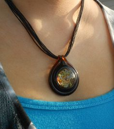 Amber Glass Pendant with multicolored by GeminiGemsDesignsbyJ, $25.00
