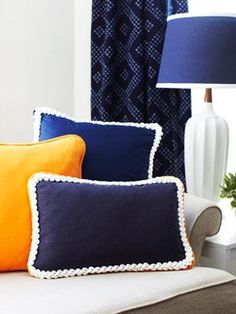 Upgrade ordinary pillows by creating this rope-trimmed look. #crafts #DIY #home