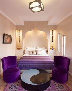 Plush purple accents breathe life into the stylish Moroccan bedroom
