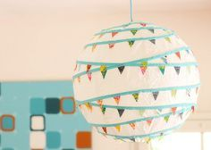 Here it is complete and hanging: a paper lantern with mini bunting.