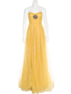 Look 46 from the Pre-Fall 2016 Runway. Yellow Gucci iridescent tulle gown with sweetheart neckline, embellished brooch at bust, thin straps, glitter accents throughout and concealed zip closure at side. Includes designer hanger and garment bag.
