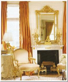 Gorgeous accents or burnt orange are beautiful as in this stunning room by Charlotte Moss