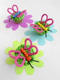 M&M'S Fluttering Cupcakes Recipe - Morph your cupcakes into beautiful butterflies with pretzel wings and M&M'S.