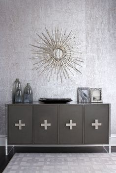 {Hardware} Muse Interiors - dining rooms - Love the hardware on the cabinet, silver sunburst mirror & silver wallpaper!