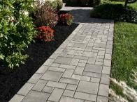 A variety of pattern options and colors from pewter to charcoal are  available in these Village Square pavers which create a sleek, clean-cut  style for your walkways and borders.  www.ephenry.com