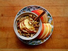 Apple cinnamon oatmeal (chopped gala apples, cinnamon, molasses, vanilla extract, ground flax seed and vanilla soy milk) topped with walnuts, apple slices, molasses, maple syrup and a cinnamon stick. (credit to @Garden of Vegan on tumblr)