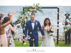 Rose petal toss at the Kukahiko Estate Maui wedding inspiration Maui wedding venue oceanfront wedding Bliss Weddings Dmitri and Sandra Photography