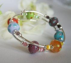 Lampwork Glass Rainbow Bracelet by DesignsByVW on Etsy, £39.95