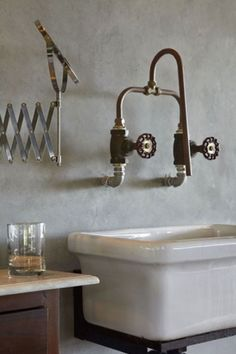 wall-mounted faucet made from copper piping and industrial water shut-off valves