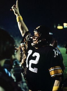 Terry Bradshaw~Quarterback Terry Bradshaw celebrates back-to-back titles after winning Super Bowl XIV at the Rose Bowl in 1980. The Steelers beat the Rams 31-19 for their fourth championship in the 1970's.