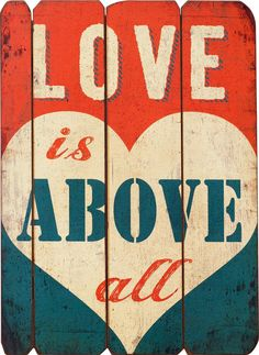 """Features:  -Material: Wood.  -Distressed red and blue wood pallet sign reading """"love is above all,"""" with white heart in the background.  -2 Metal eyelets for hanging.  Style: -Vintage.  Finish: -Multi"""