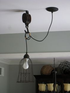 pendant light w/ pulley  I want to find ways of using the old pulleys that I found in the barn - this is one idea that could work.
