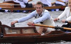 Working up a sweat: Television host Ben Fogle, sporting a cream waistcoat and shorts, puts his back into it as he rows in the manpowered flotilla