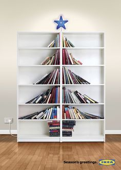 Book Tree on book shelf - Ikea catalog Book Christmas Tree, Creative Christmas Trees, Ikea Christmas, Book Tree, Christmas Decorations, Merry Christmas, Ikea Xmas, Christmas Ideas, Christmas Print