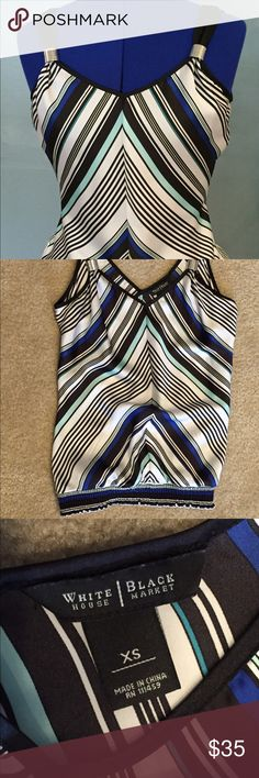 Like new gathered waist blouse Like new! White, black, blue stripes silky top with elastic gathered waistband. Metal detail on front straps. Bra strap snaps under the shoulder straps to keep your bra from showing. White House Black Market Tops Blouses