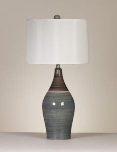 "Set of 2 Niobe Table Lamps, Becker Furniture.  Would complement the new wall color.  Nice size:  Width 15""  x  Depth 15""  x  Height 28.25""."