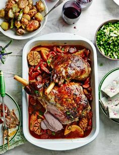 Roast lamb with chorizo, orange and parsley and simple roasties