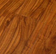 PRICE PER SF: $2.29 Natural Laminate Collection \ Golden Acacia Product #:LADGA Color:Golden Acacia Finish:Hand-Scraped Width:5 1/2 in. (145 mm) Thickness:1/2 in. (12.3 mm) Length:48 in. (1,218 mm) Click System:Unilin Click Grade:AC3 Package:20.98 sq. ft. / Carton: 42 Cartons / Pallet Weight:46 lbs / Carton Warranty:25-Year Residential Finish Warranty Trim Options:Stair Nosing / T-Molding / Threshold / Reducer / Quarter Round