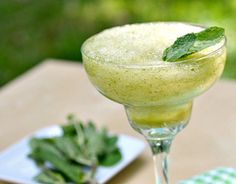 Mint Julep Frozen Margarita 10 ounces regular flavored margarita mix 1/2 cup white rum or white bourbon 1/3 cup fresh mint leaves Ice (about 5 cups)