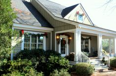 Sweet classic cottage/farmhouse exterior, board/batten, shakes, substantial trim, simple columns, roomy porch & wonderful entry. From talkofthehouse.com