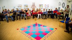 Age UK's ukelele band performing in Crown Street Art Gallery, Darlington, as part of the library's 130th anniversary celebrations