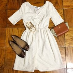 Knotted white dress Amazingly comfortable white dress with cute knotted detail at the mid-body. The fabric is stretchy and could fit multiple body types. This is a size small but could fit a medium because of the fabric's stretch. Very soft and comfortable. NOTE: Bracelets, purse and shoes are also for sale in another post! Blue Elephant Dresses