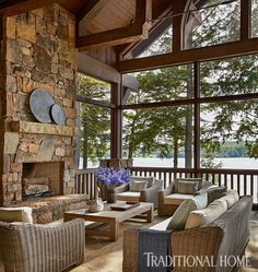 """""""Wild Horse"""" stone from Colorado was used for the exteriors and the fireplace on the lakeside porch. - Photo: Emily Jenkins Followill / Design: Beth Webb / Architect: Peter Block"""