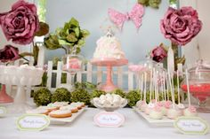 love the pink and green, white picket fence, and the stage for the cake with the green flowers