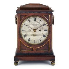 A small early Victorian mahogany mantel clock, Walter Yonge, London circa 1845 6-inch silvered dial signed Walter Yonge, Strand, London, five-pillar fusee movement with anchor escapement and trip repeat striking on a coiled gong, signed on the backplate as the dial, movement and case numbered 12014, brass-mounted case with ring side handles and scale frets