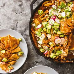 Chilaquiles is a Mexican comfort food favorite made from fried tortilla wedges tossed in a deeply flavored chile sauce. Mexican Food Recipes, Dinner Recipes, Ethnic Recipes, Mexican Dishes, Mexican Cooking, Turkish Recipes, Brunch Recipes, Breakfast Recipes, Kitchen Recipes