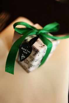 Music sheet wrapped favor boxes with guitar picks