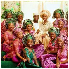 Nigerian wedding - Bride and groom with bride's friends in aso ebi attire.