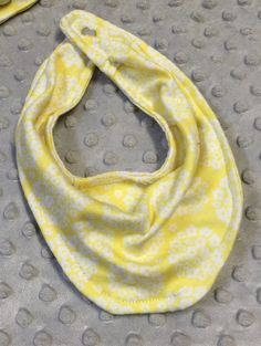Yellow and white floral jersey knit baby infinity scarf bib. Size 3-12 months by SimplyKJ on Etsy https://www.etsy.com/listing/222308162/yellow-and-white-floral-jersey-knit-baby