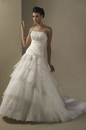 Taffeta and lace tiered gown by Venus bridal.