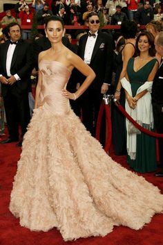 PENELOPE CRUZ Penelope may have missed out on the Best Actress accolade at the 2007 Oscars, but she won in the style stakes. Her blush feathered Versace gown ensured she made an entrance to remember, while its sheer extravagance makes it deservedly one of the most iconic dresses of the decade. (2007)
